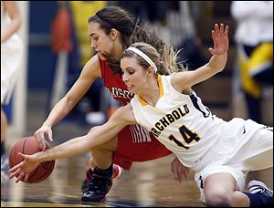 Archbold's Taylor Coressel (14) battles Wauseon's Haley Archibeque for  a loose ball during a basketball game Thursday.