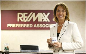 Toledo's RE/Max Preferred, office seen here with national CEO Margaret Kelly, has about 80 agents. It sold 2,024 homes last year, with more than $218 million in sales volume.