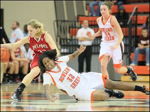 MU's #32, Hannah Robertson regains possession of the ball after BGSU's #32, Alexis Rogers tried to steal it. BGSU's #34, Bailer Cairnduff is at right.  Bowling Green State University's women's basketball team hosts the team from Miami University in Bowling Green, Ohio.