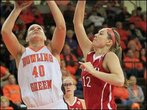 BGSU's #40, Jill Stein, shooting around MU's #12, Hannah McCue, in the first half.  Bowling Green State University's women's basketball team hosts the team from Miami University in Bowling Green, Ohio on January 24, 2013.