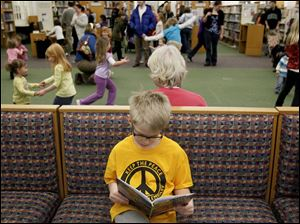 Luke Agosti, 10, of Perrysburg, elected to read a book rather than dance.