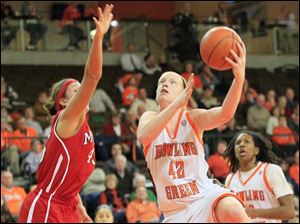 BGSU's #42, Danielle Havel shooting over MU's #45, Kirsten Olowinski.  Bowling Green State University's women's basketball team hosts the team from Miami University in Bowling Green.