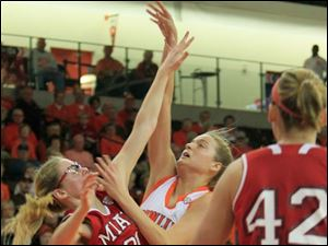BGSU's Miriam Justinger shooting over a defending MU Haley Robertson. MU #42 is Jessica Rupright.  Bowling Green State University's women's basketball team hosts the team from Miami University in Bowling Green, Ohio.