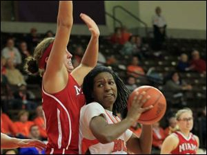 MU's Kirsten Olowinski tries to defend BGSU's Alexis Rogers in the second half.  Bowling Green State University's women's basketball team hosts the team from Miami University in Bowling Green, Ohio.