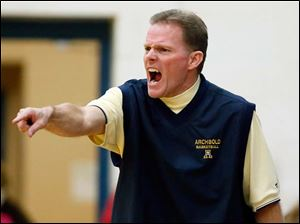 Archbold head coach Brian Ziegler shouts instructions during a basketball game against Wauseon.