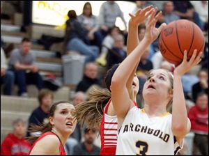 Archbold's Cassidy Williams (3) goes to the net agaoinst Wauseon defenders during a basketball game Thursday, 01/24/13, in Archbold, Ohio.
