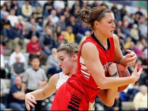 Archbold's Cassidy Wyse (15) battles Wauseon's Alyssa Reed (21) the ball during a basketball game.