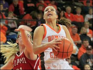 BGSU's #11, Jillian Halfhill shooting over Miami's #31, Haley Robertson.  Bowling Green State University's women's basketball team hosts the team from Miami University in Bowling Green, Ohio on January 24, 2013. The Blade/Jetta Fraser