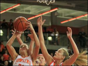 BGSU's #21, Chrissy Steffen and #30, Miriam Justinger box out MU's #31, Haley Robertson and $45, Kirsten Olowinski.  Bowling Green State University's women's basketball team hosts the team from Miami University in Bowling Green, Ohio.