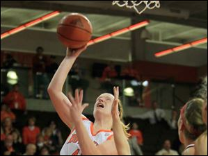 BGSU's #42, Danielle Havel shooting while defended by MU's #32, Hannah Robertson in the second half.  Bowling Green State University's women's basketball team hosts the team from Miami University in Bowling Green, Ohio.