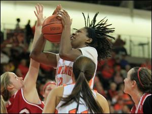 BGSU's Alexis Rogers grabs an offensive rebound while defended by MU's #32, Hannah Robertson.  Bowling Green State University's women's basketball team hosts the team from Miami University in Bowling Green, Ohio on January 24, 2013. The Blade/Jetta Fraser
