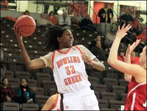BGSU's Alexis Rogers in bounds the ball just before it goes out of bounds against BGSU.  Bowling Green State University's women's basketball team hosts the team from Miami University in Bowling Green, Ohio.