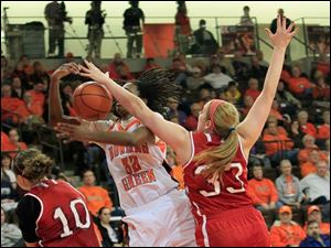 BGSU's Alexis Rogers is fouled by MU's #33, Erica Almady. MU #10 is Courtney Osborn.  Bowling Green State University's women's basketball team hosts the team from Miami University in Bowling Green, Ohio.