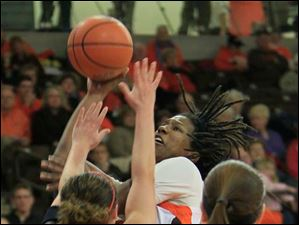 BGSU's Alexis Rogers shooting over MU's #10, Courtney Osborn in the first half. BGSU #11 is Jillian Halfhill.  Bowling Green State University's women's basketball team hosts the team from Miami University in Bowling Green.