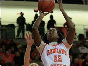 BGSU's Alexis Rogers shooting after getting by MU's #33, Erica Almady in the first half.  Bowling Green State University's women's basketball team hosts the team from Miami University.
