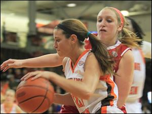 Bowling Green State University's women's basketball team hosts the team from Miami University head coach Maria Fantanarosa, left signals is a play. Third from Fantanarosa is assistant coach mark Ehlen. Bowling Green State University's women's basketball team hosts the team from Miami University.