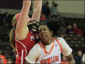 MU's #33, Erica Almady tries to defend BGSU's #32, Alexis Rogers.  Bowling Green State University's women's basketball team hosts the team from Miami University in Bowling Green.