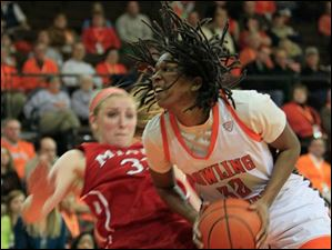 MU's #33, Erica Almady, fouling BGSU's Alexis Rogers in the second half.  Bowling Green State University's women's basketball team hosts the team from Miami University in Bowling Green.