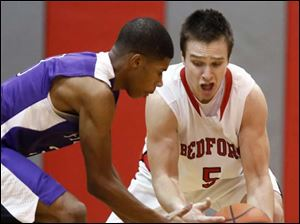 Bedford's Bradley Boss (5) steals the ball from Ann Arbor Pioneer's Duane Simpson-Redmond (3) in Bedford, Michigan. Bedford defeated Ann Arbor 56-54.