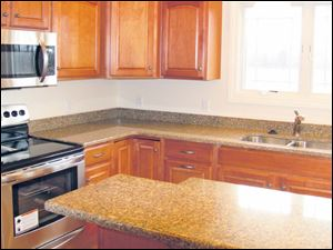 There is plenty of workspace in this lovely kitchen. Quality maple cabinets are topped with granite.
