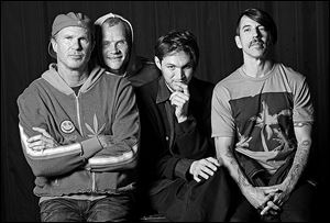 The Red Hot Chili Peppers, from left, drummer Chad Smith, bassist Flea, guitarist Josh Klinghoffer, and singer Anthony Kiedis will headline Coachella 2013.