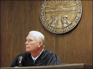 Visiting Judge Thomas Lipps listens to arguments on whether the rape trial should be open to the public.