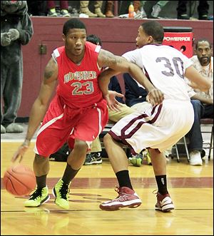 Bowsher's Nate Allen, left, drives past Scott's Bryson Collins. Allen scored a team-high 20 points for the Rebels, while Collins finished with 16 points and 10 rebounds.