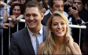 Canadian jazz singer Michael Buble and his Argentinian actress wife, Luisana Lopilato, are expecting their first baby together,