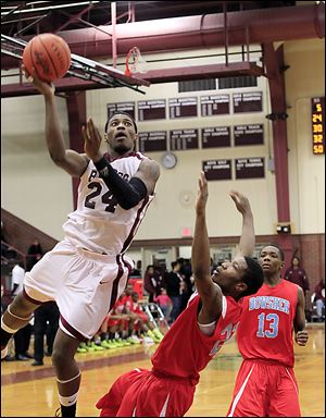 Jermul Richardson, left, had a game-high 24 points. Defending for Bowsher are Josh Porter, center, and Dajuan King.