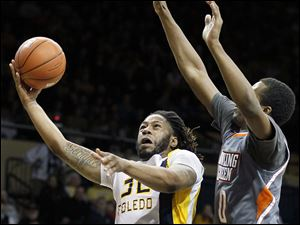 University of Toledo forward Reese Holliday takes a shot against Bowling Green State University forward Spencer Parker.