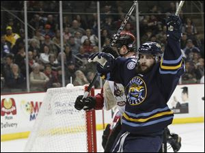 Toledo Walleye player Cody Lampl, 32, celebrates after scoring a goal to put the Walleye ahead of the Bakersfield Condors 2-1 in the first period.