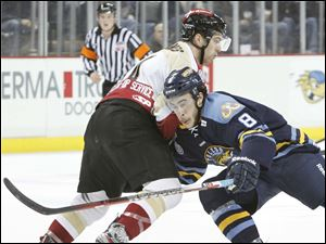 Toledo Walleye player Trevor Parkes, 8, is stopped by Bakersfield Condors player Kyle Haines, 4.