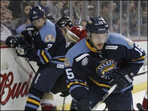 Toledo Walleye player Willie Coetzee, 15, comes up with the puck against the Bakersfield Condors during the first period.
