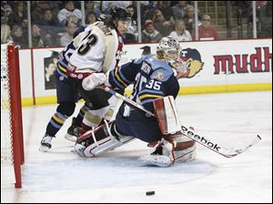 Toledo Walleye goalie Kent Simpson, 35, blocks a shot.
