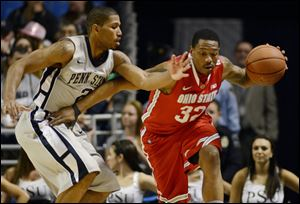 Ohio State's Lenzelle Smith Jr. (32) works past Penn State's D.J Newbill (2) during the first half of an NCAA college basketball game in State College, Pa.
