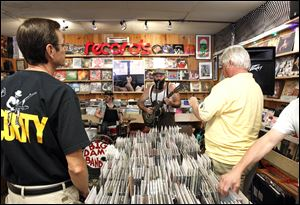Reverend Peyton's Big Damn Band plays an in-store concert at Culture Clash on Secor Rd.