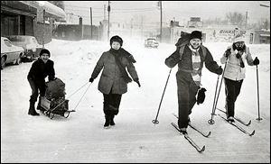 Lloyd, left, and Margaret Apling use a sled while Ray, second from right, and Mary O'Donnell use cross-country skis to go grocery shopping.