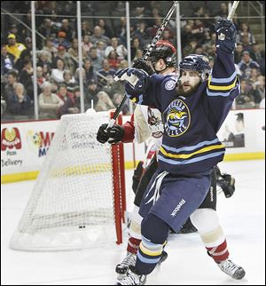 Toledo's Cody Lampl celebrates after scoring a goal to put the Walleye ahead during the first period. His goal helped Toledo to a 5-1 victory over Bakersfield.