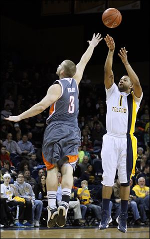 UT guard Dominique Buckley, who led the Rockets with 20 points, shoots a 3-point-shot against Bowling Green's Luke Kraus in Saturday night's game at Savage Arena.