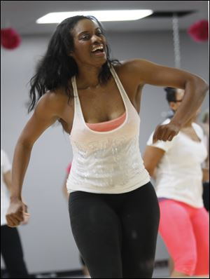 Exercise trainer Shanika Kynard works out at Exquisite Physiques.