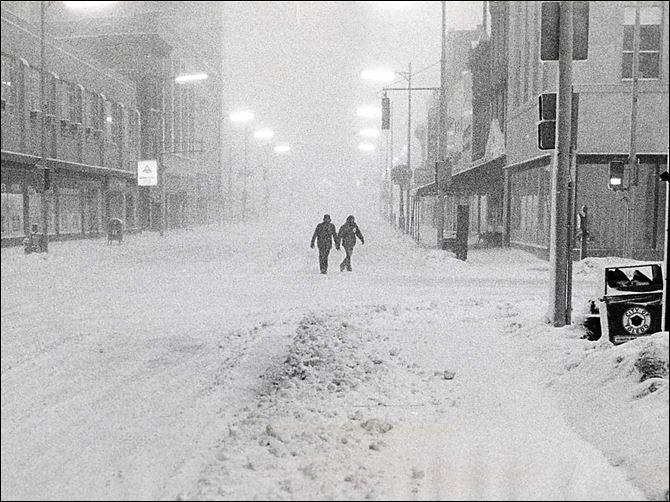 1978 blizzard solitary pair A solitary pair make their way east on Adams Street approaching Huron street in downtown Toledo.