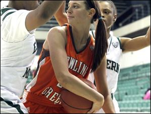 BGSU's Chrissy Steffen looks for a pass between two Eastern Michigan's defenders.