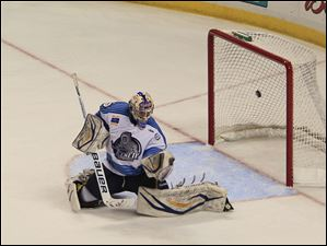 Icemen goalie Paul Karpowich looks at his empty glove after the Walleye's Willie Coetzee scored at 15:21 in the third period to put the team up 2-0. Nino Musitelli had the assist.