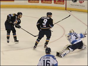 The Walleye's Stephon Thorne, left, scores against Icemen goalie Paul Karpowich at 19:45 of the third period, to put the team up 4-1. The assist went to Kyle Rogers, not pictured.