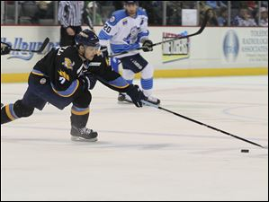 Toledo's Nino Musitelli reaches for the puck in front of the goal.