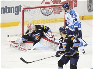 Walleye goalie Jordan Pearce made 29 saves, including this one in the third period.