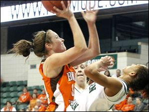 BGSU's Bailey Cairnduff shoos over Eastern Michigan's Desyree Thomas.