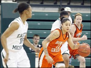BGSU's Katrina Salinas, center, breaks away from Eastern Michigan's Desyree Thoma.