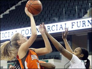BGSU's Miriam Justinger shootswhile being defended by Eastern Michigan's India Hairston.