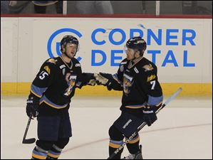 The Walleye's Willie Coetzee, right, and Nino Musitelli celebrate after Coetzee's third-period goal.